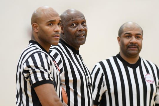 From left, referees Myke Foster, Lawrence Miller, and Walter Strong Jr. stand during halftime in a high school boys basketball game game between against U-D Jesuit and Detroit Loyola last month at Marian High School in Bloomfield Hills.