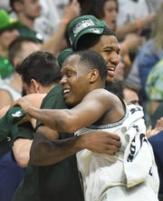 Michigan State's Cassius Winston and Aaron Henry hug as Winston comes out of the game late in the second half.