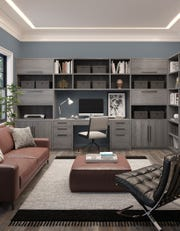 "A traditional modern office can serve different functions with an efficient design. Easy-to-open drawers and cabinets organize supplies, while cubbies and bookshelves provide more storage vertically in this Paxton Office system, featured in the popular ""ash"" color."