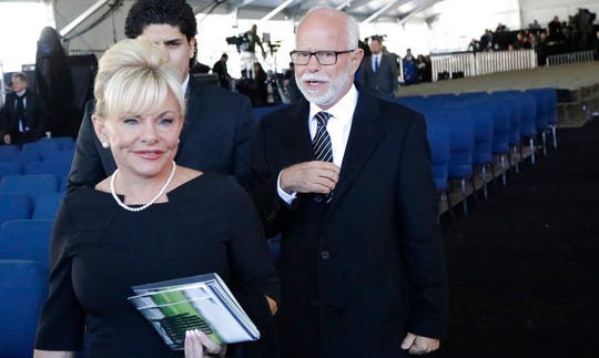 Televangelist Jim Bakker, right, walks with his wife Lori Beth Graham after a funeral service for the Rev. Billy Graham in this March 2, 2018, file photo in Charlotte, N.C. New York's attorney general has demanded that Bakker stop falsely promoting pricey pills as a cure for the coronavirus.