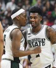Michigan State's Cassius Winston and Rocket Watts chat during a break in the action In the second half.