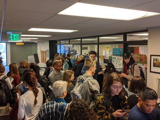 Students and residents wait outside the Ann Arbor city clerk's office to register to vote or cast absentee ballots on Monday, March 9, 2020. The city said voters waited between 30 minutes and an hour to be processed on the eve of Michigan's presidential primary.