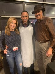 From left, WDIV's Kim Degiulio with Josh Landon and Huel Perkins from Fox 2 News at Empty Bowls