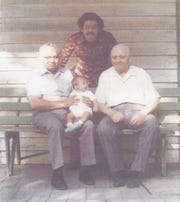 Four generations of Llorens men, with James standing above his father, grandfather and less-than-year-old son.