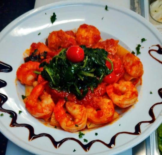 Shrimp and spinach top rigatoni in marinara sauce at Ristorante Enrico.