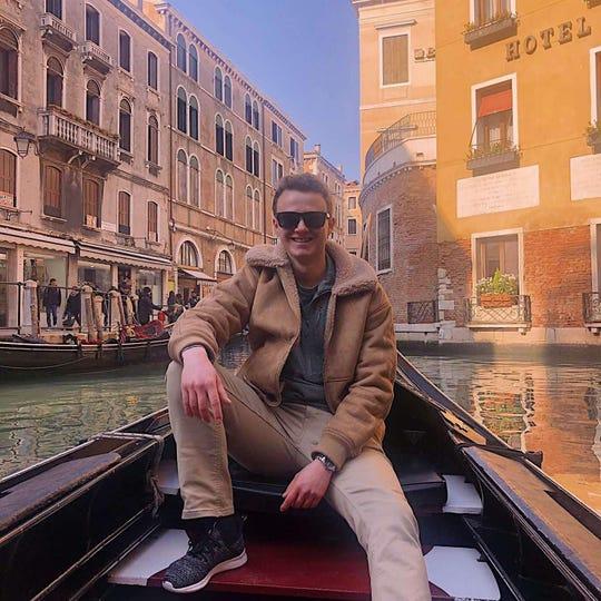 Eric Calder taking a gondola ride in Venice