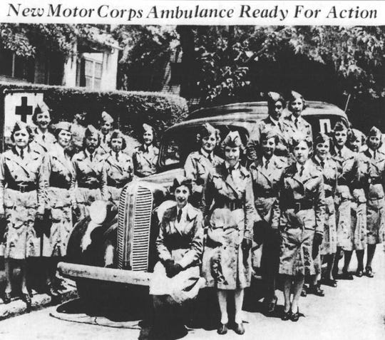 In July 1942, the 20 members of Greenville's ambulance corps with captain Anne Vaughn pose with their new ambulance truck.