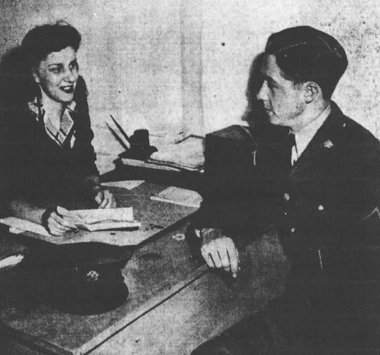 Two weeks after Pearl Harbor, home service secretary Frontis Keys helps a Private Dillard straighten out some problems.