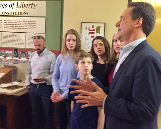 Members of the Bullock family -- Caroline, Cameron, Alex and first lady Lisa -- look on Monday as Gov. Steve Bullock discusses his run for U.S. Senate.