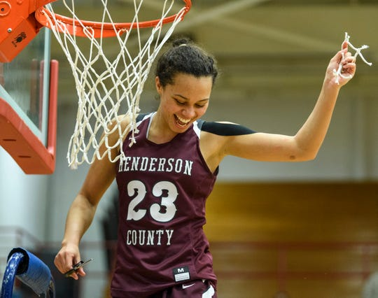 Henderson County's Jocelyn Spaulding (23) smiles as she shows the crowd her piece of net after the team's second region championship win at Christian County High School in Hopkinsville, Ky., Saturday, March 7, 2020. The Lady Colonels defeated the Lady Maroons, 66-49.