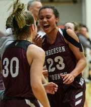 Henderson County's Jocelyn Spaulding (23) celebrates with Emilee Hope (30) as they win the second region championship against the Madisonville-North Hopkins Lady Maroons at Christian County High School in Hopkinsville, Ky., Saturday, March 7, 2020. The Lady Colonels defeated the Lady Maroons, 66-49.