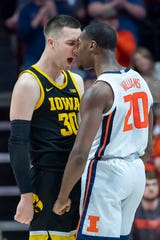 Iowa Hawkeyes guard Connor McCaffery (30) and Illinois Fighting Illini guard Da'Monte Williams (20) confront each other, afterwards receiving each a technical foul, during the first half at State Farm Center.