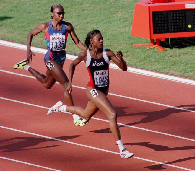 Macial Malone (1048) battles with Jearl Miles (1335), both of Gainesville, Fla., down the backstretch of their heat in the women's 400-meter semifinals at the Olympic track trials in Atlanta, Monday, June 17, 1996. Malone took first, followed by Miles in the heat. (AP Photo/Eric Risberg)