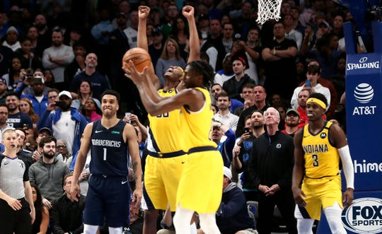 Mar 8, 2020; Dallas, Texas, USA; Indiana Pacers center Myles Turner (33) and teammates celebrate the victory against the Dallas Mavericks at American Airlines Center. Mandatory Credit: Kevin Jairaj-USA TODAY Sports
