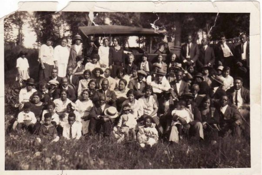 "A 1930 photo from a gathering of the various members of three Grinnell-area African American families at Grinnell's Arbor Lake.  The image was used on the cover of ""Grinnell Stories: African Americans of Early Grinnell."""