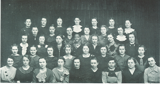 "The UI Home Economics Club from the 1936 ""Hawkeye.""At the center of the photo is Evanel Renfrow, one of the subjects of Kaiser's book and the lone African American among the 37 women in the image."