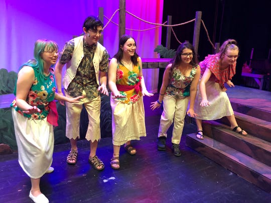 "These islanders are part of the chorus in the Spencer-Van Etten spring musical, ""Once on This Island,"" this week in the high school auditorium. From left are Elizabeth Stephens-Cook, Alex Decker, Sydney Myrick, Raquel Hatch and Izabell Bacon."