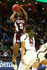 Mar 8, 2020; Greenville, SC, USA; Mississippi State Bulldogs forward Rickea Jackson (5) shoots the ball against South Carolina Gamecocks guard Tyasha Harris (52) during the first half during the SEC Conference Championship at Bon Secours Wellness Arena. Mandatory Credit: Jeremy Brevard-USA TODAY Sports