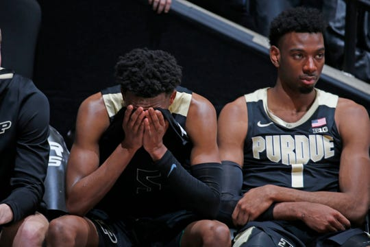 Mar 7, 2020; West Lafayette, Indiana, USA;  From left to right Purdue Boilermakers guard Eric Hunter Jr. (2)  and forward Aaron Wheeler (1) react after the game to losing against the Rutgers Scarlet Knights in overtime at Mackey Arena. Mandatory Credit: Brian Spurlock-USA TODAY Sports