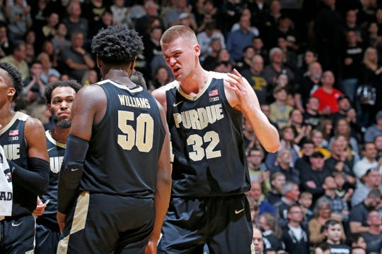 Mar 7, 2020; West Lafayette, Indiana, USA; Purdue Boilermakers center Matt Haarms (32) talks to forward Trevion Williams (5) in a game against the Rutgers Scarlet Knights during the second half at Mackey Arena. Mandatory Credit: Brian Spurlock-USA TODAY Sports