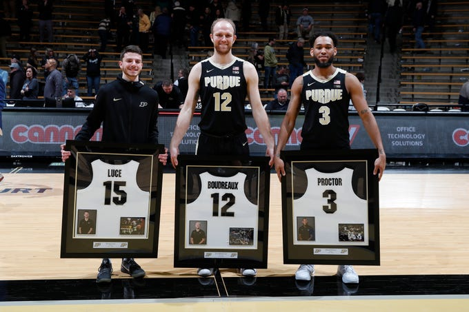 Mar 7, 2020; West Lafayette, Indiana, USA; From left to right Purdue Boilermakers seniors Tommy Luce (15) and Evan Boudreaux (12) and Jahaad Proctor (3) are honored on Senior Day after the game against the Rutgers Scarlet Knights at Mackey Arena. Mandatory Credit: Brian Spurlock-USA TODAY Sports