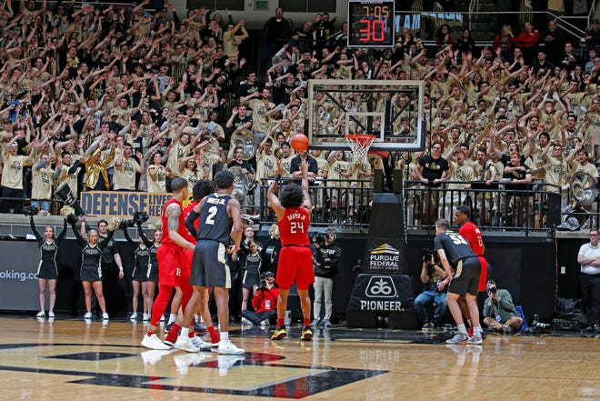 Mar 7, 2020; West Lafayette, Indiana, USA; Rutgers Scarlet Knights guard Ron Harper Jr. (24) shoots a free throw while the Purdue Boilermakers student section tries to distract him during the second half at Mackey Arena. Mandatory Credit: Brian Spurlock-USA TODAY Sports