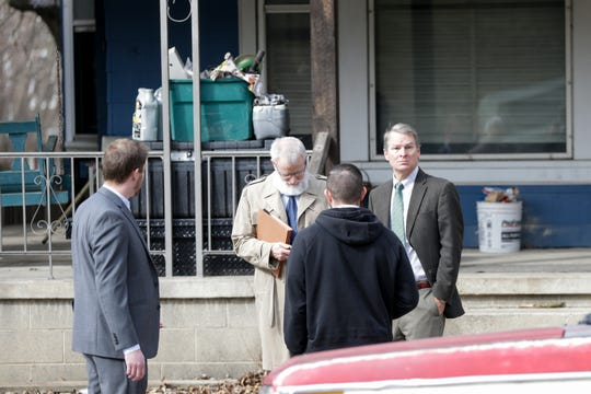 Tippecanoe County Prosecutor Patrick Harrington looks around while talking outside of a house on the 500 block of North Seventh Street where Donald Alkire, 29, was fatally stabbed in the neck Saturday night following a confrontation, Monday, March 9, 2020 in Lafayette.