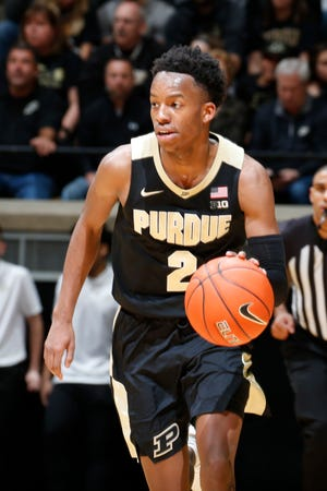 Mar 7, 2020; West Lafayette, Indiana, USA; Purdue Boilermakers guard Eric Hunter Jr. (2) brings the ball up court against the Rutgers Scarlet Knights during the second half at Mackey Arena. Mandatory Credit: Brian Spurlock-USA TODAY Sports