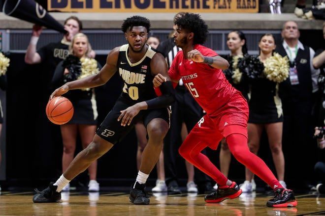 Purdue forward Trevion Williams (50) drives on Rutgers center Myles Johnson (15) during the first half of an NCAA college basketball game in West Lafayette, Ind., Saturday, March 7, 2020. (AP Photo/Michael Conroy)