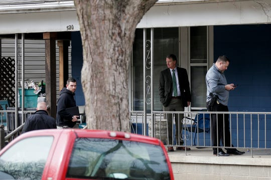 Tippecanoe County Deputy Prosecutor Cassidy Laux, second from left, looks at the camera as he, County Prosecutor Patrick Harrington, second from right, and Lafayette Police Department Lt. Tim Payne, and other members of law enforcement walk into a house on the 500 block of North Seventh Street where Donald Alkire, 29, was fatally stabbed in the neck Saturday night following a confrontation, Monday, March 9, 2020 in Lafayette.