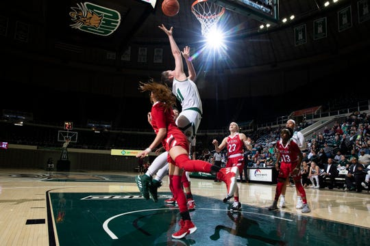 Gabby Burris puts up the ball to score her 1,000th career point Sunday against Miami University. Burris, a junior, is a former Liberty Union standout.