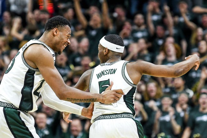 Xavier Tillman and Cassius Winston celebrate during their final game at MSU, a win over Ohio State last March at Breslin. Both were selected in the second round of Wednesday's NBA draft. Tillman is headed to the Memphis Grizzlies, Winston to the Washington Wizards.