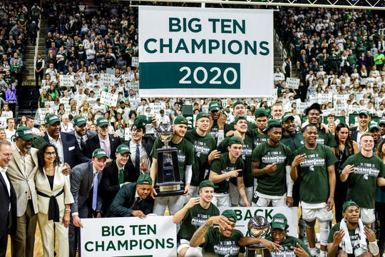 Michigan State poses after beating Ohio State on Sunday, March 8, 2020, at the Breslin Center in East Lansing. The Spartans won a share of the Big Ten Championship.