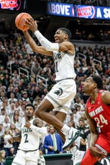 Michigan State's Aaron Henry scores during the second half on Sunday, March 8, 2020, at the Breslin Center in East Lansing.