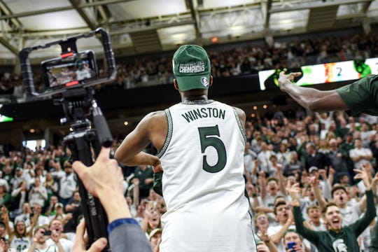 Michigan State's Cassius Winston celebrates after beating Ohio State on Sunday, March 8, 2020, at the Breslin Center in East Lansing. The Spartans won a share of the Big Ten Championship.