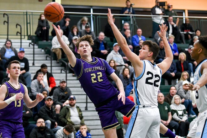 Even though Fowlerville is moving up to Class A in 2020-21, Billy Hutchins (22) and the school's other varsity basketball players will still compete in the Division 2 state tournament.