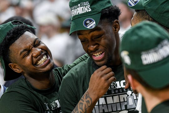 Michigan State's Rocket Watts, left, and Gabe Brown celebrate after beating Ohio State on Sunday, March 8, 2020, at the Breslin Center in East Lansing. The Spartans won a share of the Big Ten Championship.