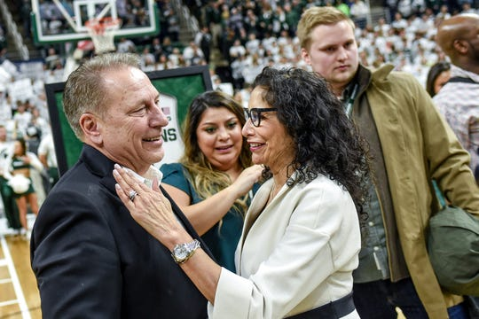 Michigan State's head coach Tom Izzo, left, hugs wife Lupe Izzo after beating Ohio State on Sunday, March 8, 2020, at the Breslin Center in East Lansing. The Spartans won a share of the Big Ten Championship.