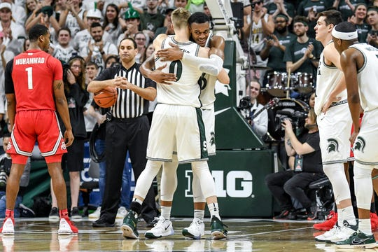 Michigan State's Kyle Ahrens, left, hugs Xavier Tillman before coming out of the game during the second half on Sunday, March 8, 2020, at the Breslin Center in East Lansing.