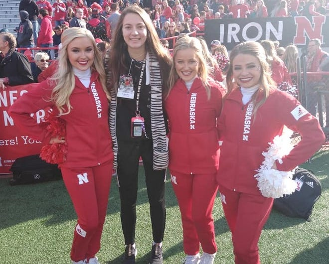 Nebraska-bound track star Kerrigan Myers of Galion with some of the school's cheerleaders while attending a Cornhuskers football game on a recruiting visit last November.