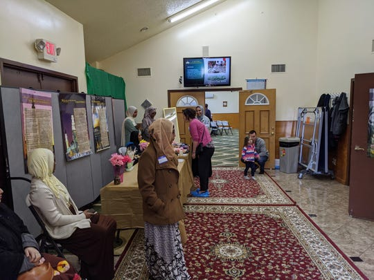 "Booths with Islamic information and a headscarf tutorial are set up at Masjid Al-Noor during the ""Open Mosque Day"" event March 7."