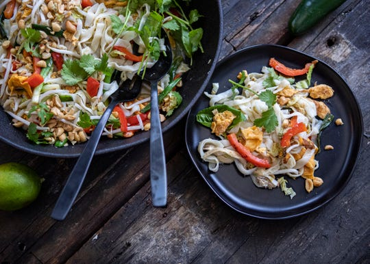 """A plate of Pad Thai with Lemongrass and Shirataki Noodles is seen on a table on Friday, March 6, 2020. The recipe is in """"Low-Carb Vegetarian Cookbook"""" by  Justin Fox Burks and Amy Lawrence, the duo behind The Chubby Vegetarian blog."""