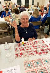 On March 6, the Knights of Columbus San Marco Council #6344 hosted a Bingo Night in the San Marco Parish Center. Above, the jackpot winner, Mary Piche of Ontario.