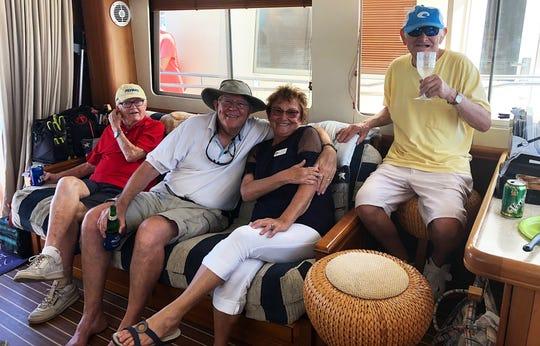 "Jack Babb, John Marsh, Sara Beckley and John Nevalus, aboard ""Knot So Fast."""
