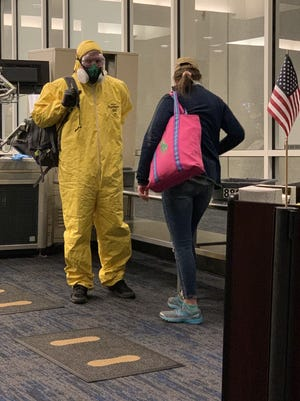 Charlie Quaintance wore a hazmat suit to the Milwaukee Mitchell Airport over the weekend to avoid exposure to coronavirus.