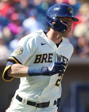 Christian Yelich of the Brewers rounds first base after singling against the Angels in the fourth inning.