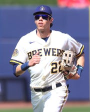 Christian Yelich heads to the dugout from his spot in left field during the Brewers' game against the Angels.