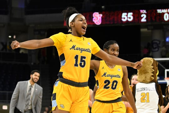 Marquette forward Camryn Taylor celebrates after the Golden Eagles beat St. John's to advance to the Big East title game.