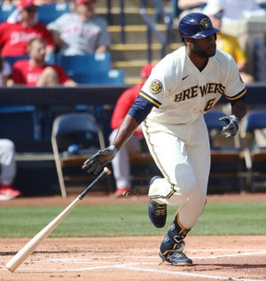 Lorenzo Cain of the Brewers grounds out during the first inning against the Angels.