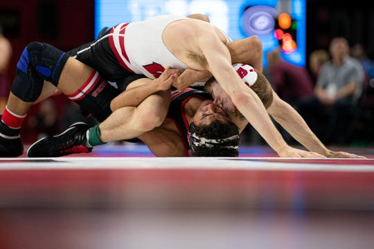 Seth Gross (top) got a national shoutout for his Badgers wrestling season (and his engagement) .